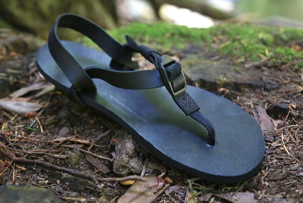 Shamma All Blacks sandal on forest floor