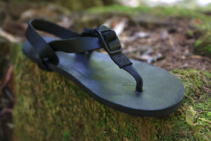 Shamma All Blacks sandal on mossy rock