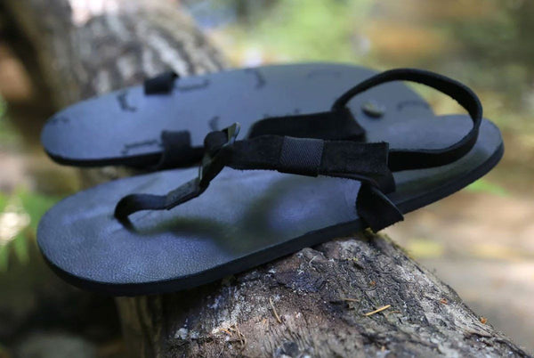 Shamma All Blacks sandals on forest branch