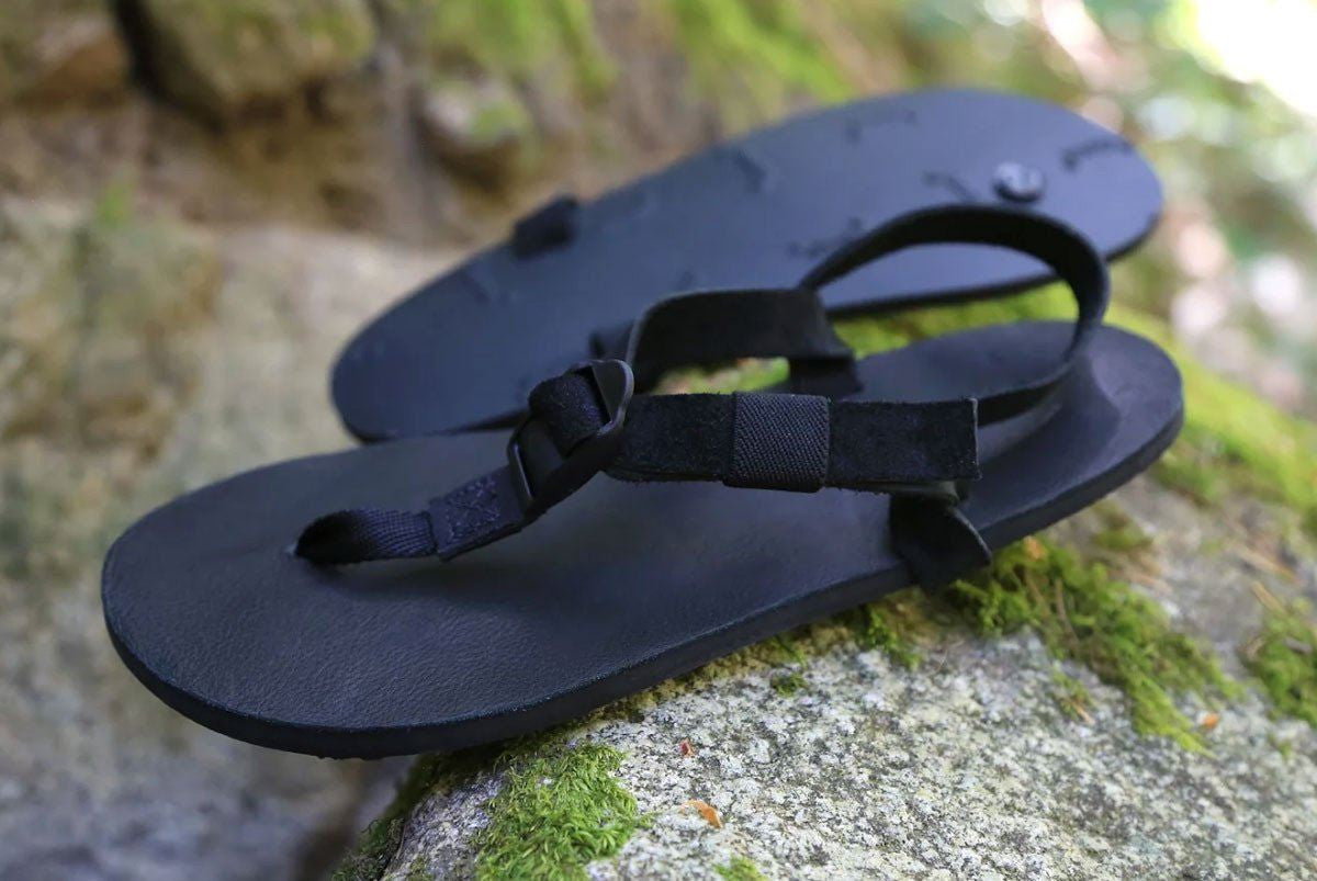 All Blacks sandals on moss rocks