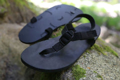 Shamma All Blacks sandals on mossy rocks