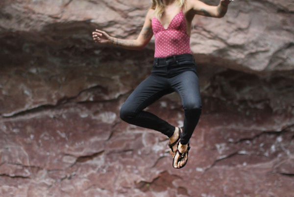 Shamma All Browns Sandals woman jumping in air