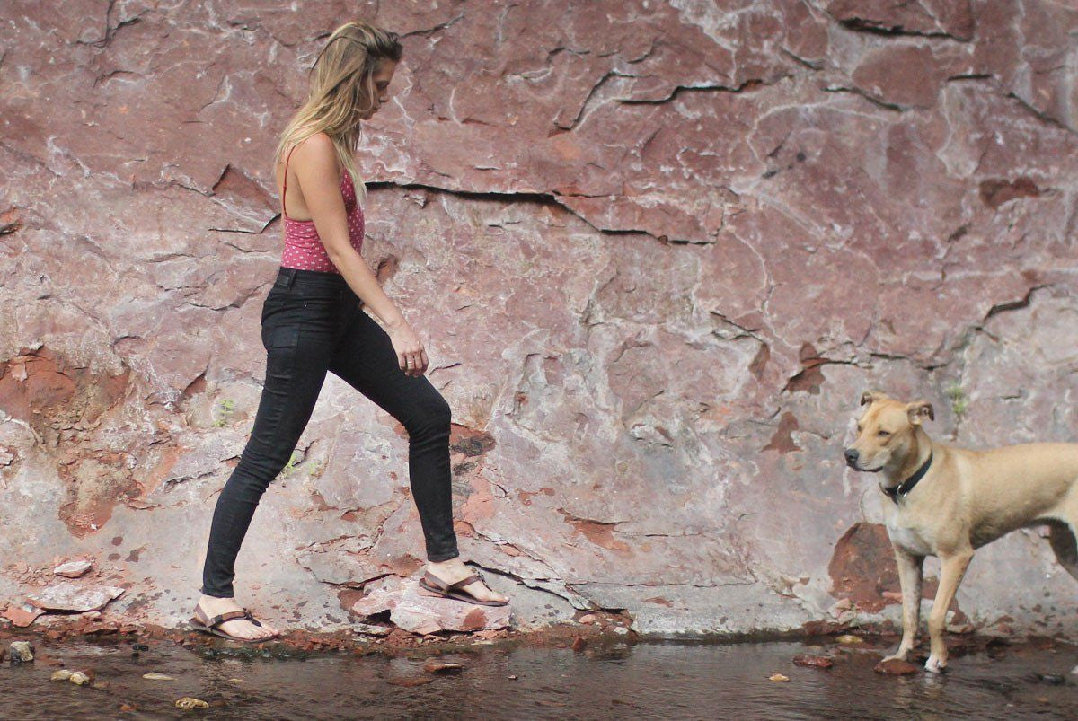 All Browns sandals woman walking in canyon with dog