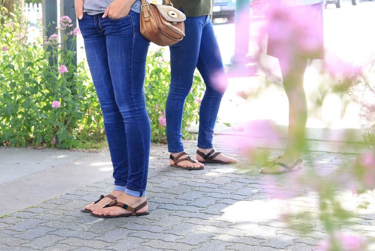 Women standing in All Browns sandals