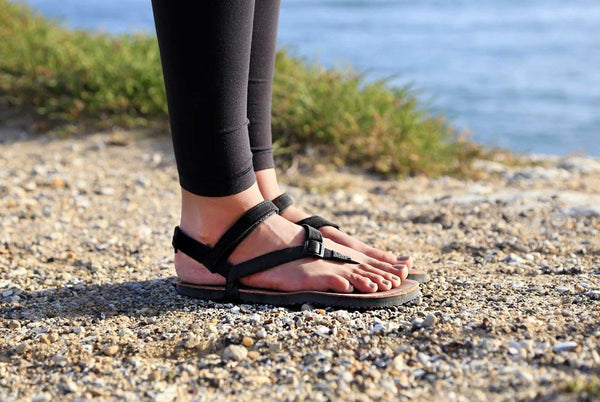 Woman standing in Shamma Sandals with Power Straps