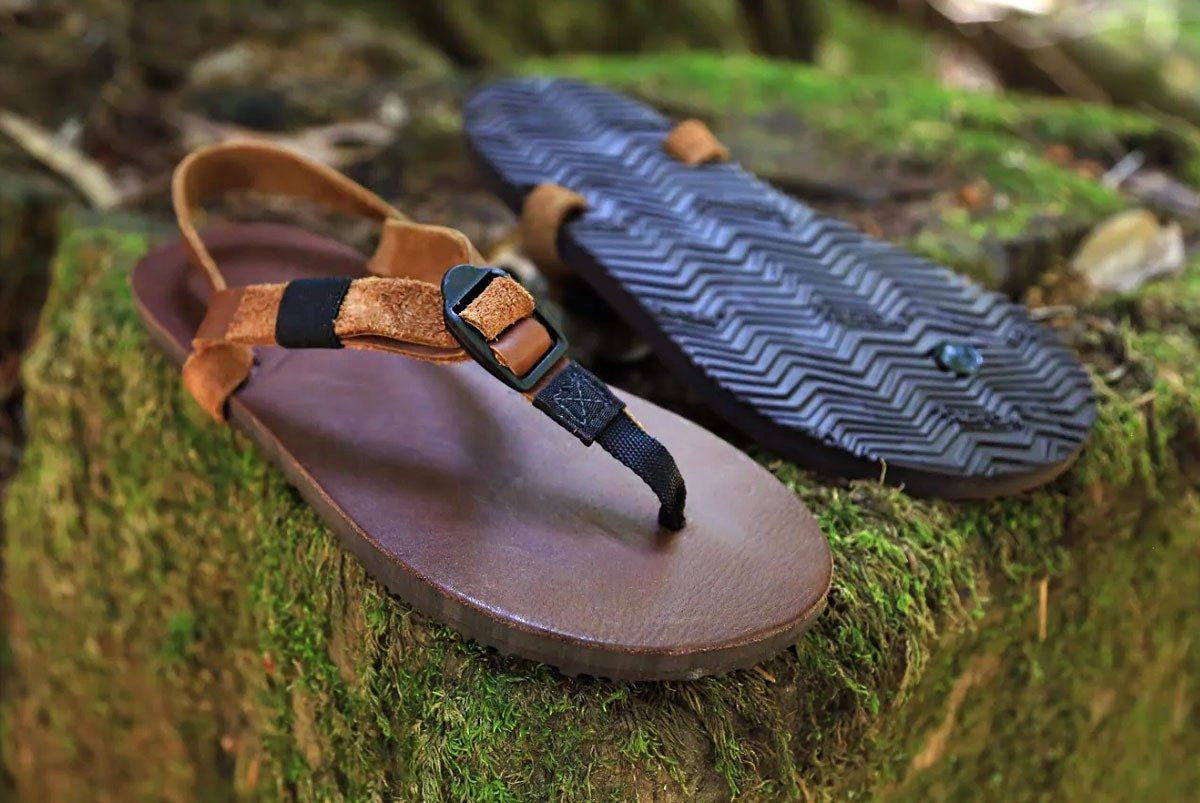 Shamma Old Goats leather sandals on mossy rocks three quarter view