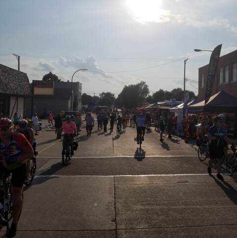 RAGBRAI riders checking out exhibits as the sun sets