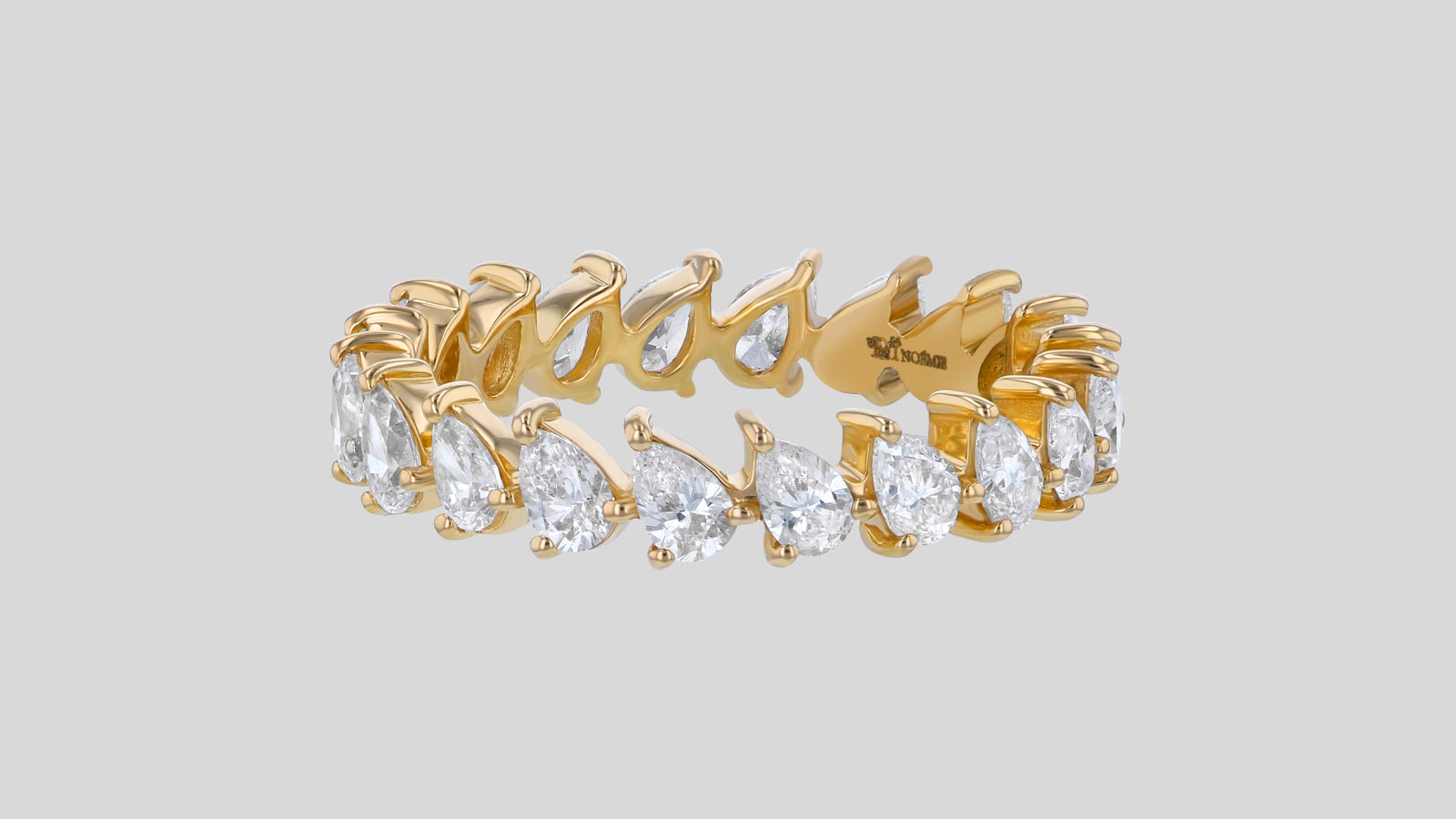 //cdn.shopify.com/s/files/1/1043/0216/files/pear-gold-rose-white-platinum-eternity-2_1600x.jpg?v=3259091945617449497