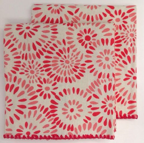 Linen kitchen towel in two tone floral in red and pink round patterns with shell stitched edging