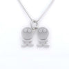 Straight on view of silver pendant necklace with groovy twins figures aside each other.