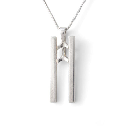 Straight on view of Sterling silver pendant of two prominent vertical bars symbolizing twins.