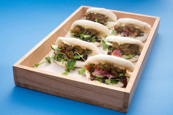 Gua Bao with Eggplant Kasundi, Mayonnaise, Red Onion Pickle, Peanuts, Microgreens and Coriander