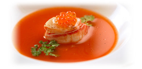 CARROT POTAGE WITH CRAYFISH MEDALLIONS AND HERB LEAVES