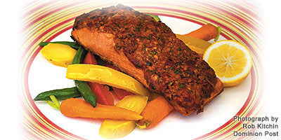 GRILLED SALMON FILLETS WITH SUNDRIED TOMATO PESTO ON A CRUNCHY VEGETABLE SALAD