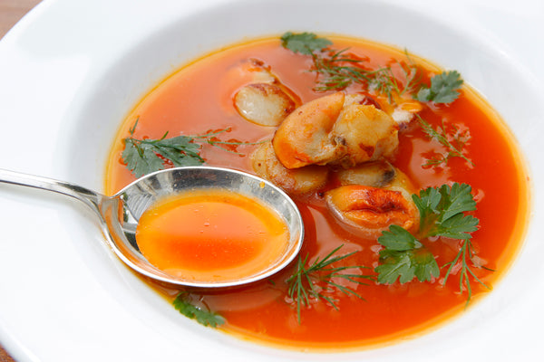 Carrot Soup with Scallops and Herb Leaves