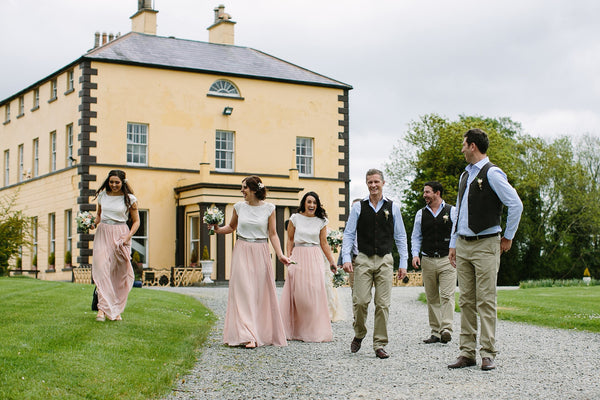 Siobhain Real Wedding Image blush bridsmaid skirts and ivory tops