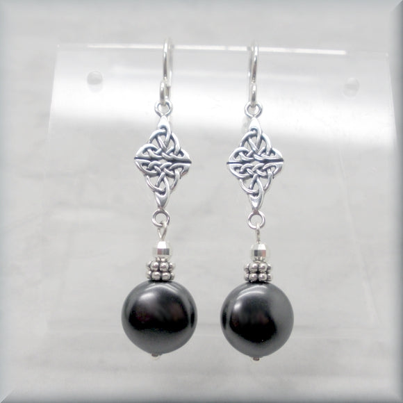 Coin pearl earrings with Celtic knot accent