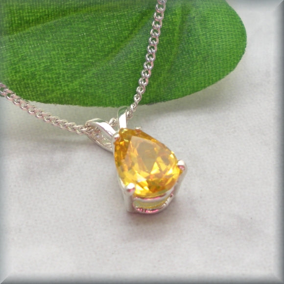 Golden yellow pear shaped cubic zirconia in sterling silver setting by Bonny Jewelry