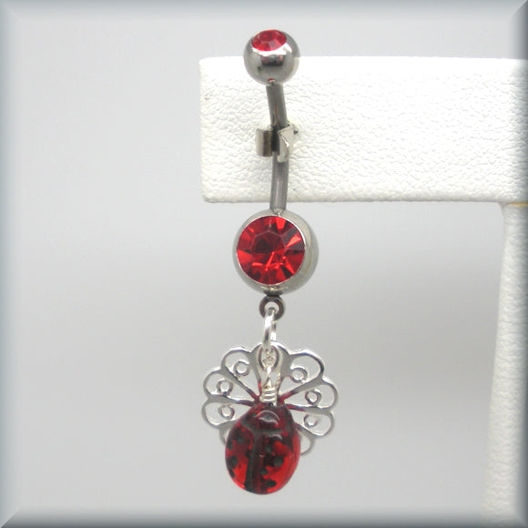 Red crystal belly ring with ladybug on flower