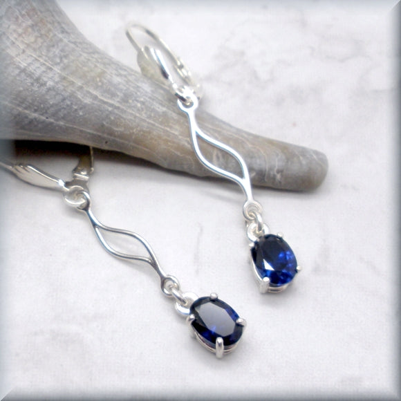 Blue sapphire earrings with wave accent