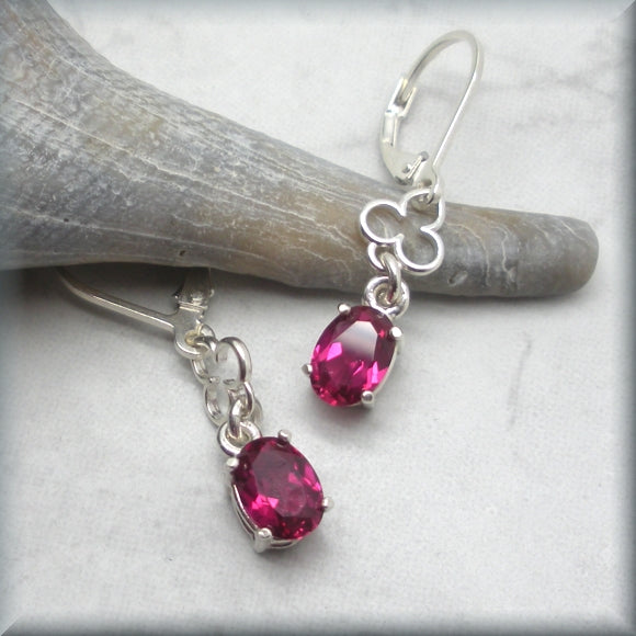 faceted oval ruby leverback earrings