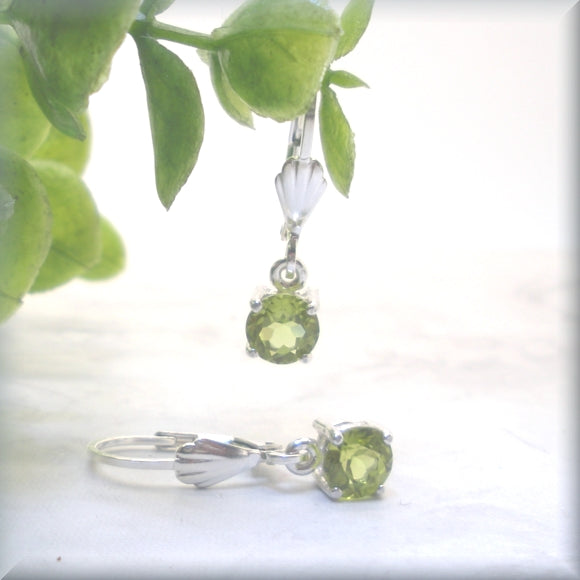 round faceted peridot earrings