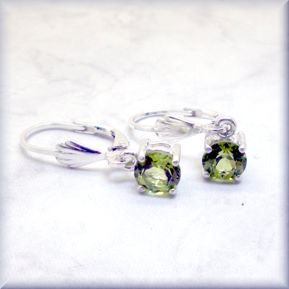 august birthstone earrings with round peridot faceted stones