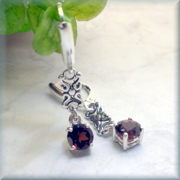 faceted round garnet earrings in sterling silver