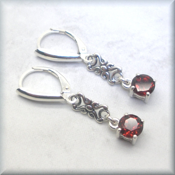 January birthstone earrings with round garnet stones