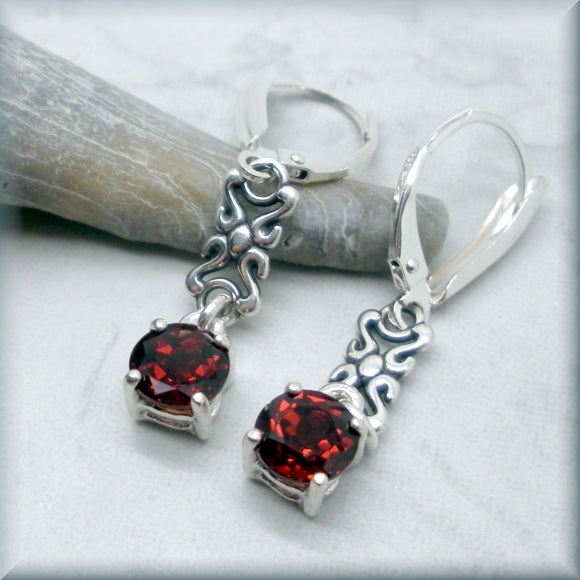 Round garnet earrings with rope accent