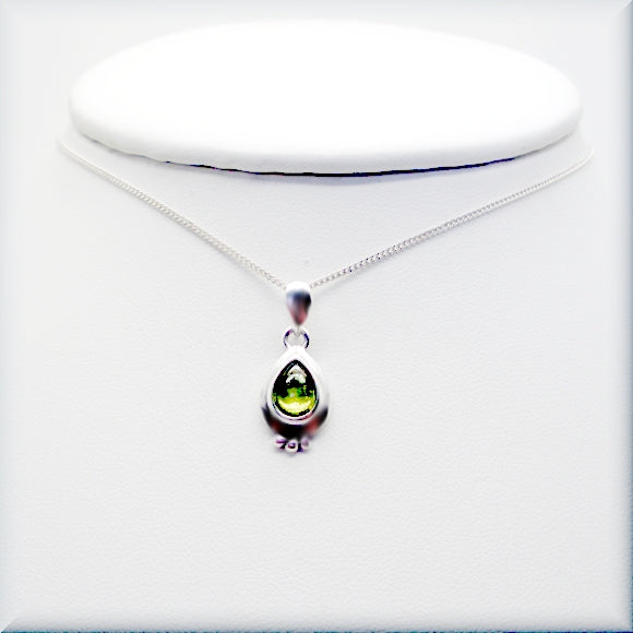 Peridot cabochon necklace in pear shape on sterling silver