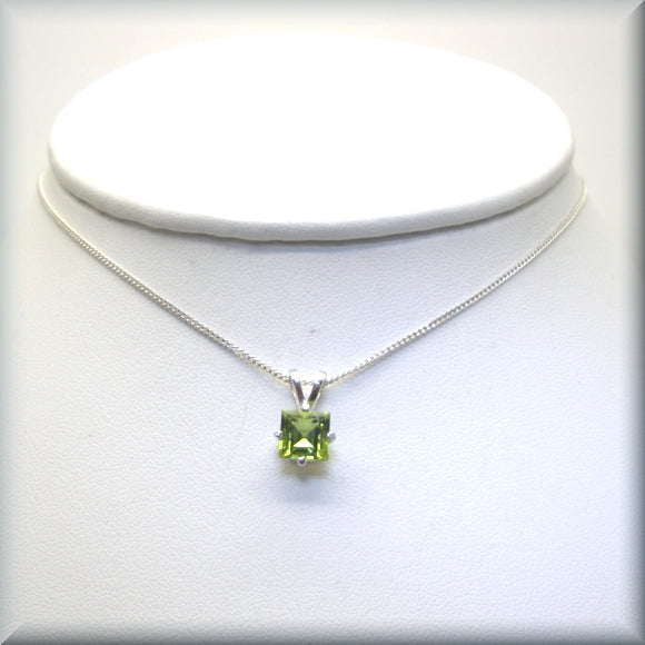 Peridot gemstone necklace on sterling silver curb chain