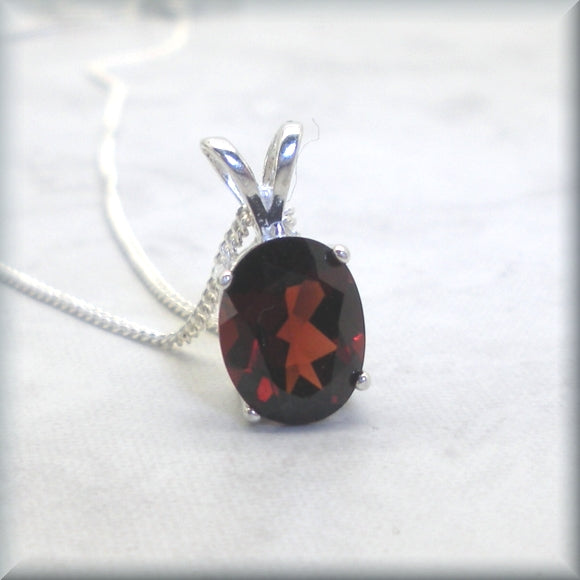 Oval garnet necklace in basket setting