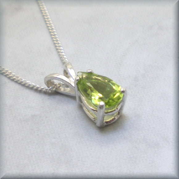 Peridot gemstone necklace in sterling basket setting