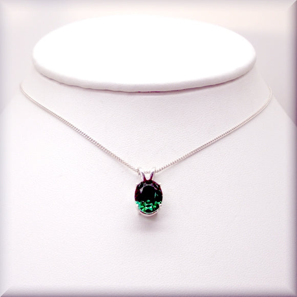 Vibrant emerald necklace in an oval cut with sterling silver chain