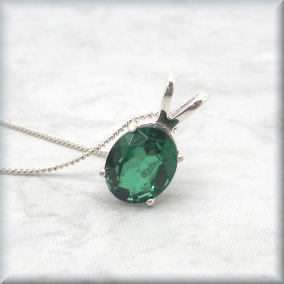 Emerald necklace in sterling silver basket setting