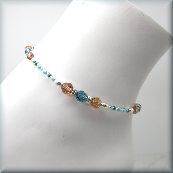 Beaded crystal anklet in dark aqua and brown tones