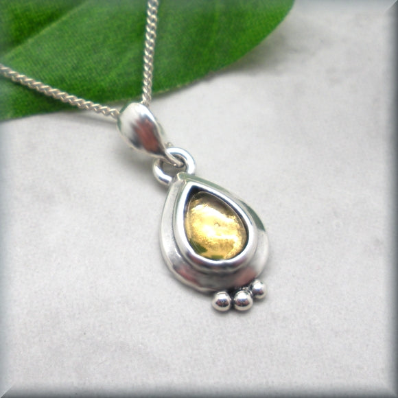 golden citrine pear shaped cabochon in sterling silver