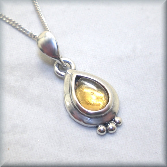 citrine cabochon set in pear shape sterling silver setting
