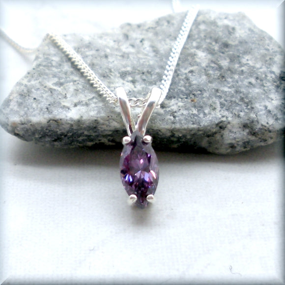 Amethyst Cubic Zirconia on a rock