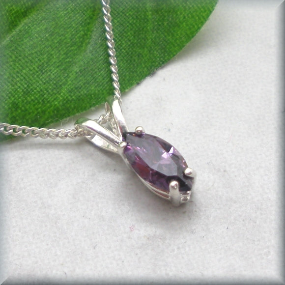 Amethyst CZ necklace displayed again a leaf