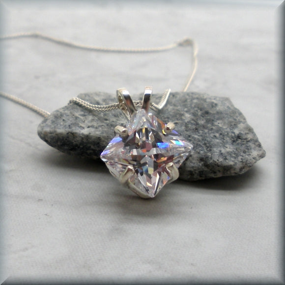 Large cz pendant displayed on rock