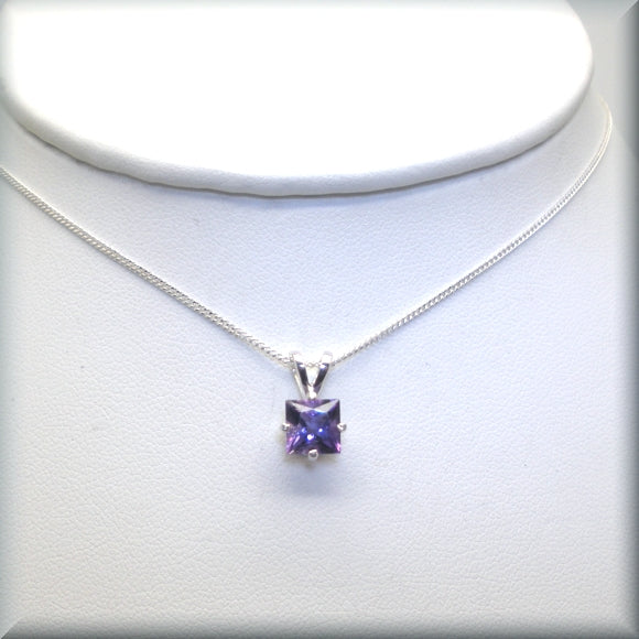Purple amethyst princess cut necklace on display bust