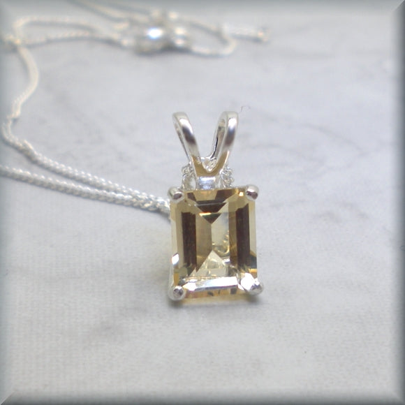 Emerald cut citrine necklace set in sterling silver