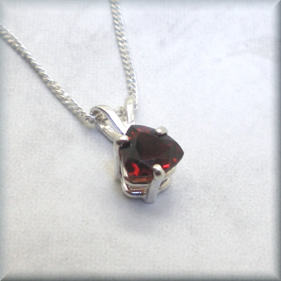 Natural garnet pendant in a faceted trillion cut