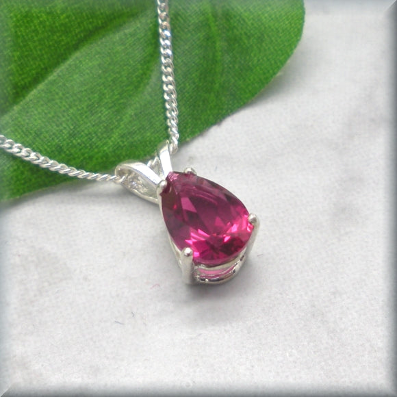 Ruby gemstone necklace in sterling silver basket setting