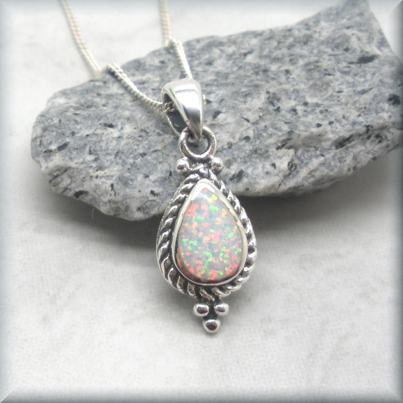 wihte opal necklace with rope edge design setting