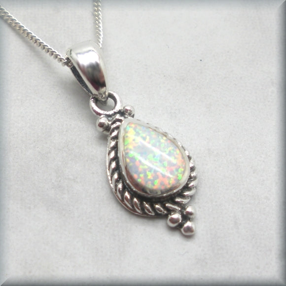 white opal cabochon pendant with rope detail edge