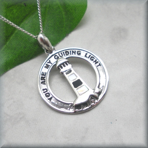 symbolic lighthouse necklace in sterling silver