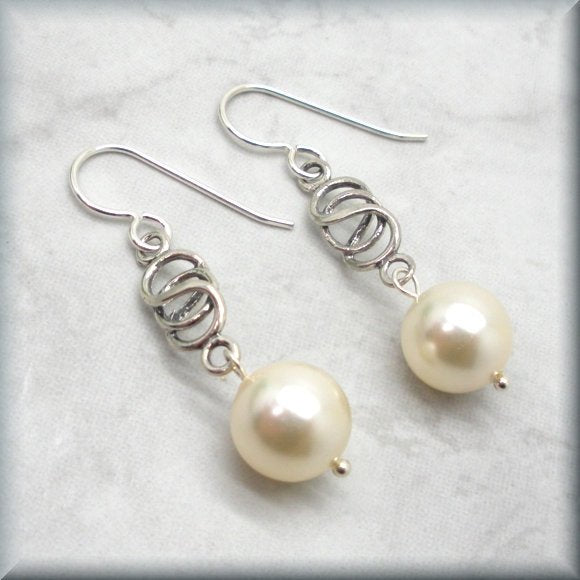 White pearl drop earrings with Celtic knot design by Bonny Jewelry